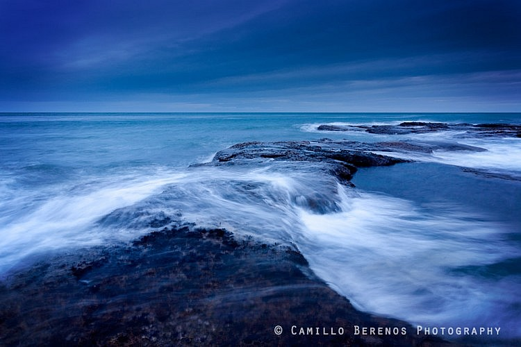 Large waves hit the reef during the blue hour, at the East Lothian coast near Dunbar. More through luck than anything else, my camera and I managed to stay dry.