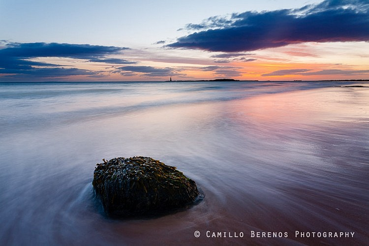 Lonely rock awaiting sunrise, near North Berwick. St Baldred's boat can be seen in the distance.