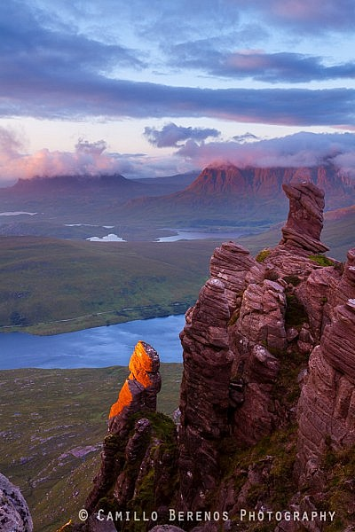 Beautiful Torridonian sandstone rock formations glowing in red evening light with Suilven and Cul Mor in Assynt in the background. Not long after this spectacle the clouds reappeared and all views were gone.